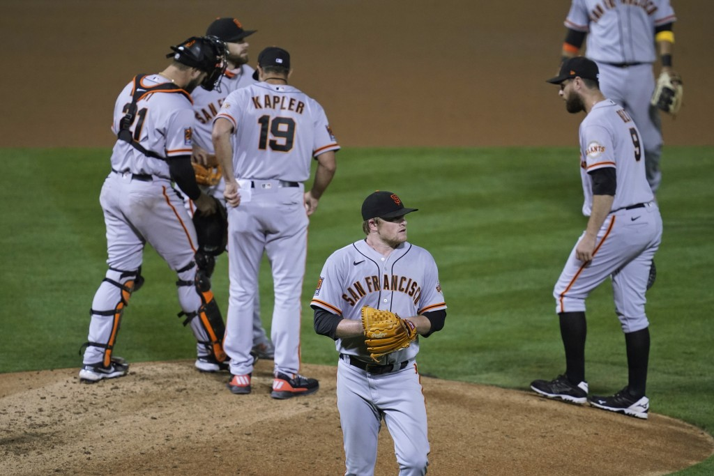 San Francisco Giants starting pitcher Logan Webb walks back to the dugout after being removed by manager Gabe Kapler (19) in the fourth inning of the ...