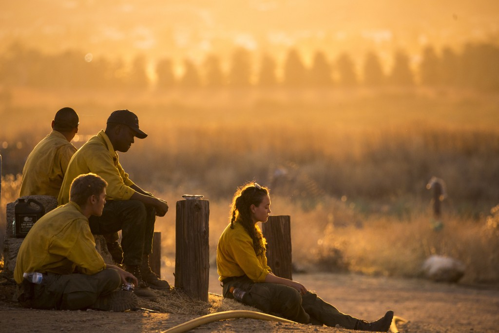 Firefighters rest during a wildfire in Yucaipa, Calif., Saturday, Sept. 5, 2020. Firefighters trying to contain the massive wildfires in Oregon, Calif...