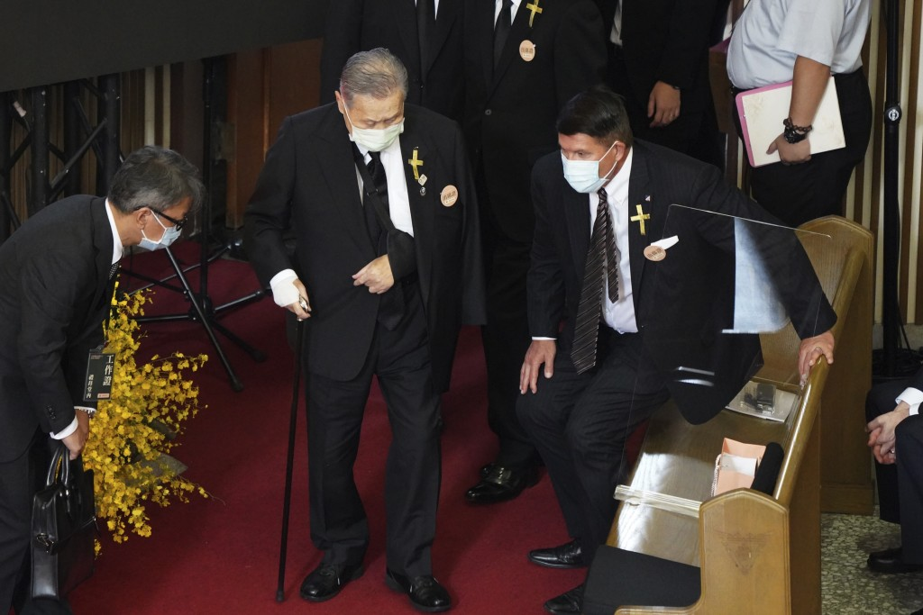 U.S. Undersecretary of State Keith Krach, at right rise as former Japanese Prime Minister Yoshiro Mori center arrives at a memorial service for the la...