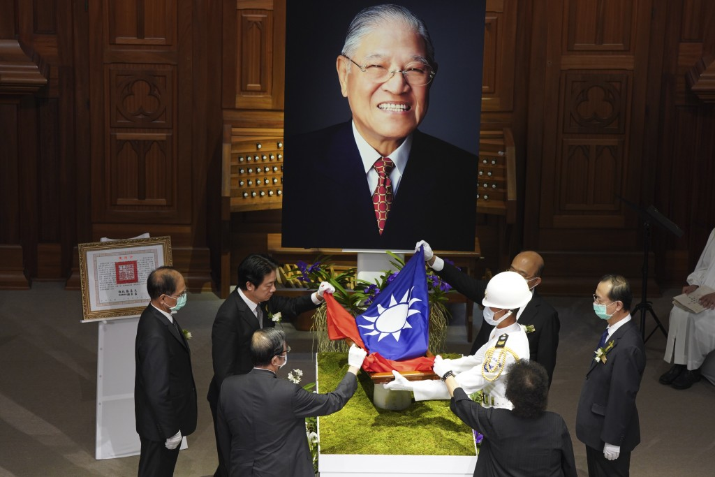 A Taiwanese flag is laid during a memorial service for the late former Taiwanese President Lee Teng-hui in Taipei, Taiwan on Saturday, Sept. 19, 2020....