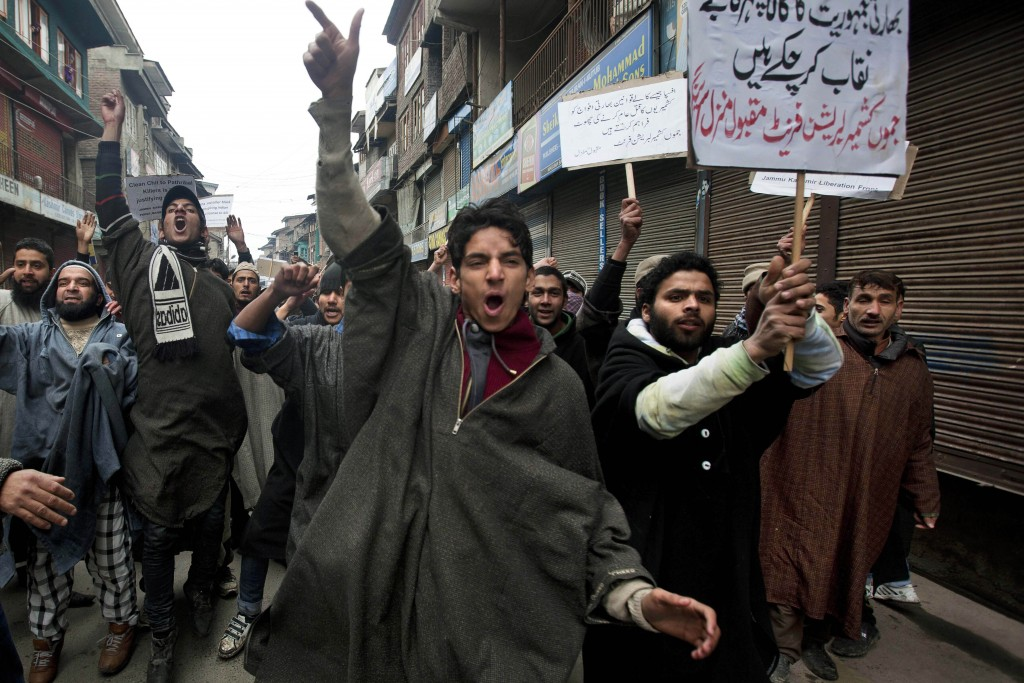 FILE - In this Friday, Jan. 31, 2014, file photo, Activists of Jammu Kashmir Liberation Front (JKLF) shout slogans during a protest against the Indian...