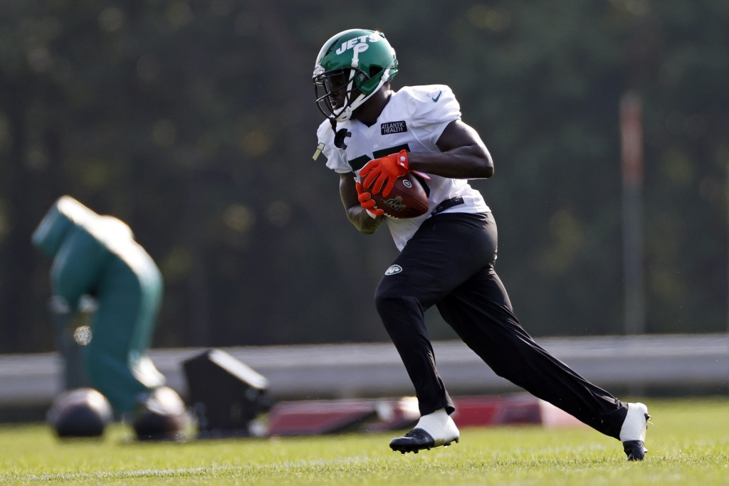 FILE - In this Aug. 25, 2020, file photo, New York Jets running back Frank Gore runs with the ball during a practice at the NFL football team's traini...