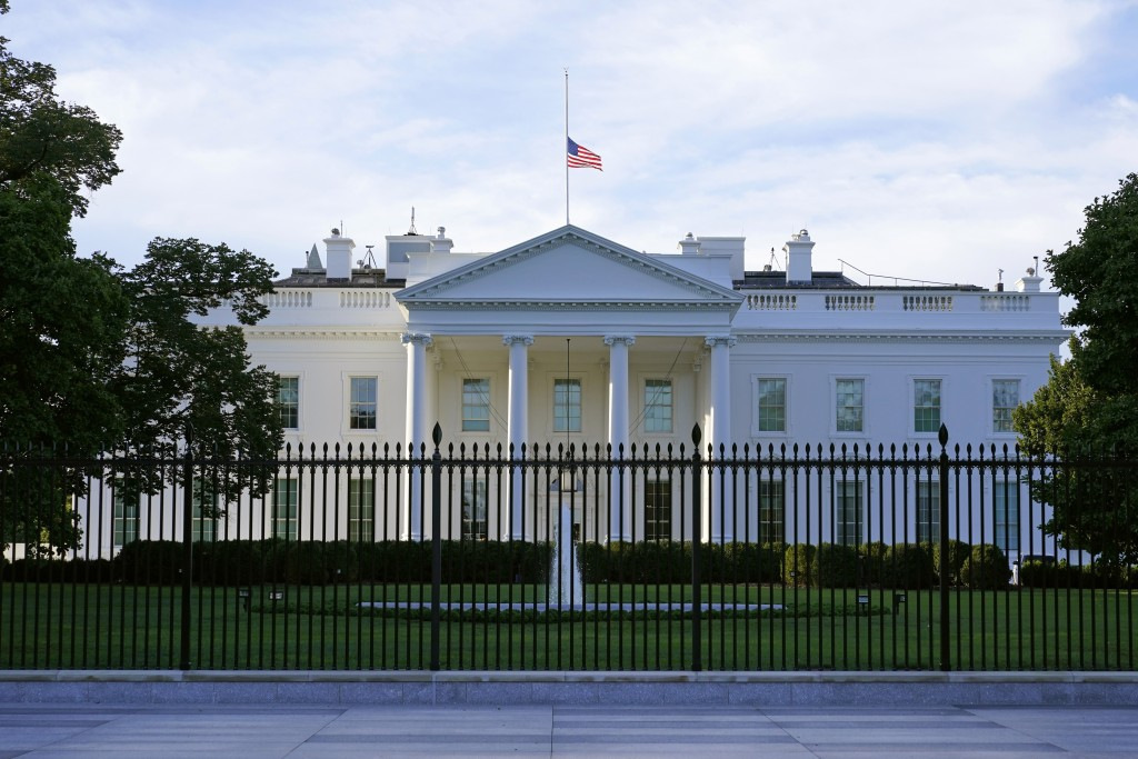 An American flag flies at half-staff over the White House in Washington, Saturday, Sept. 19, 2020, the morning after the death of Supreme Court Justic...