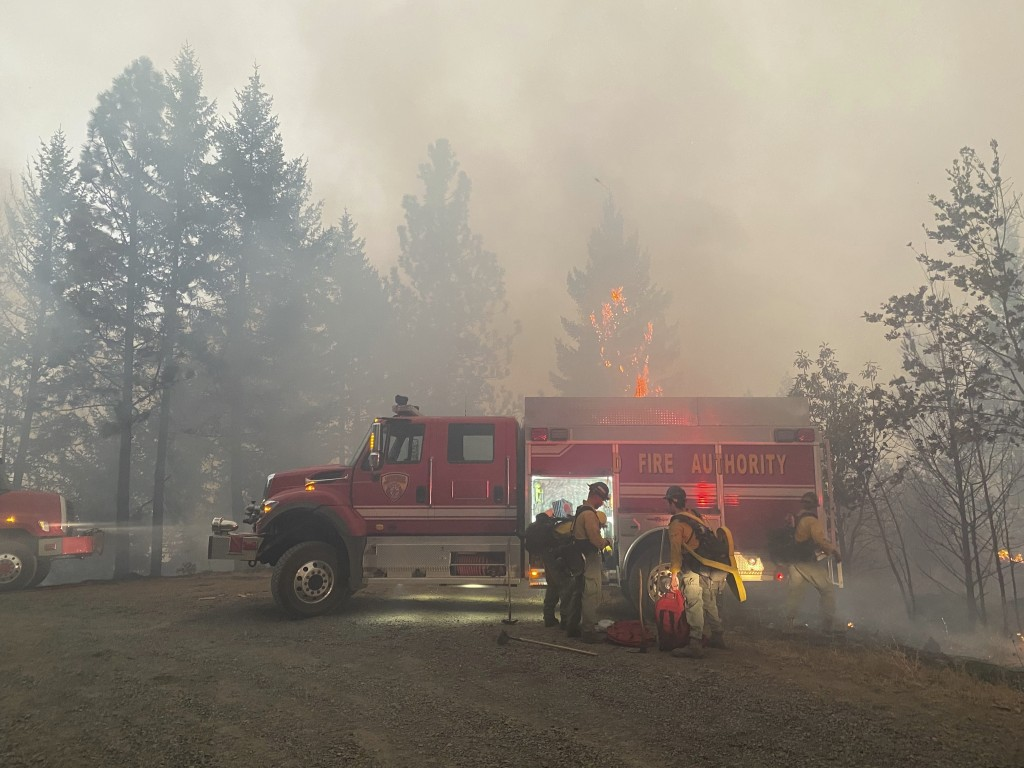 This photo provided by the Unified Fire Authority shows Utah fire crews prepare to fight wildfires near Butte Falls in southern Oregon on Saturday, Se...