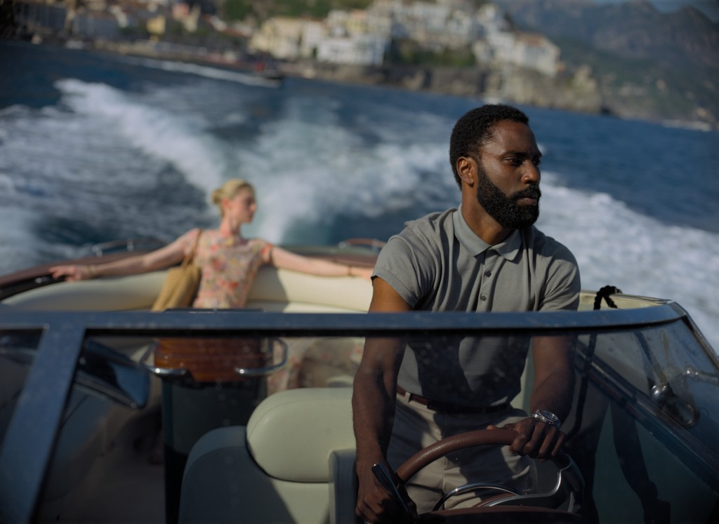 """This image released by Warner Bros. Entertainment shows Elizabeth Debicki, left, and John David Washington in a scene from """"Tenet.""""  As """"Tenet"""" enters..."""