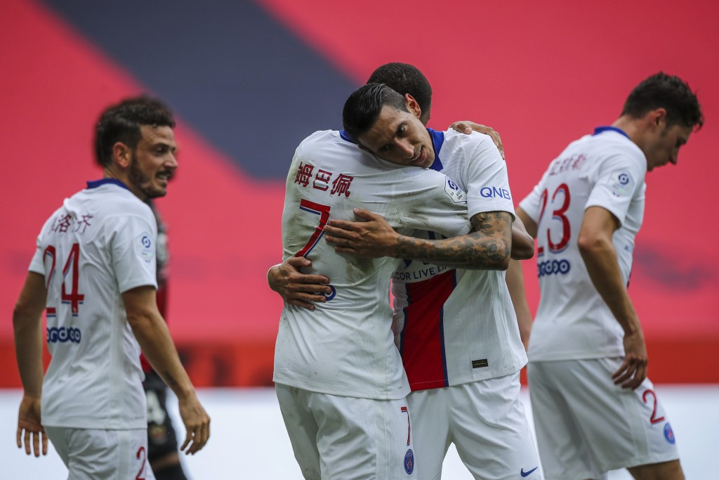 PSG's Angel Di Maria, second right, is congratulated by teammate Kylian Mbappe after scoring during the French League One soccer match between Nice an...