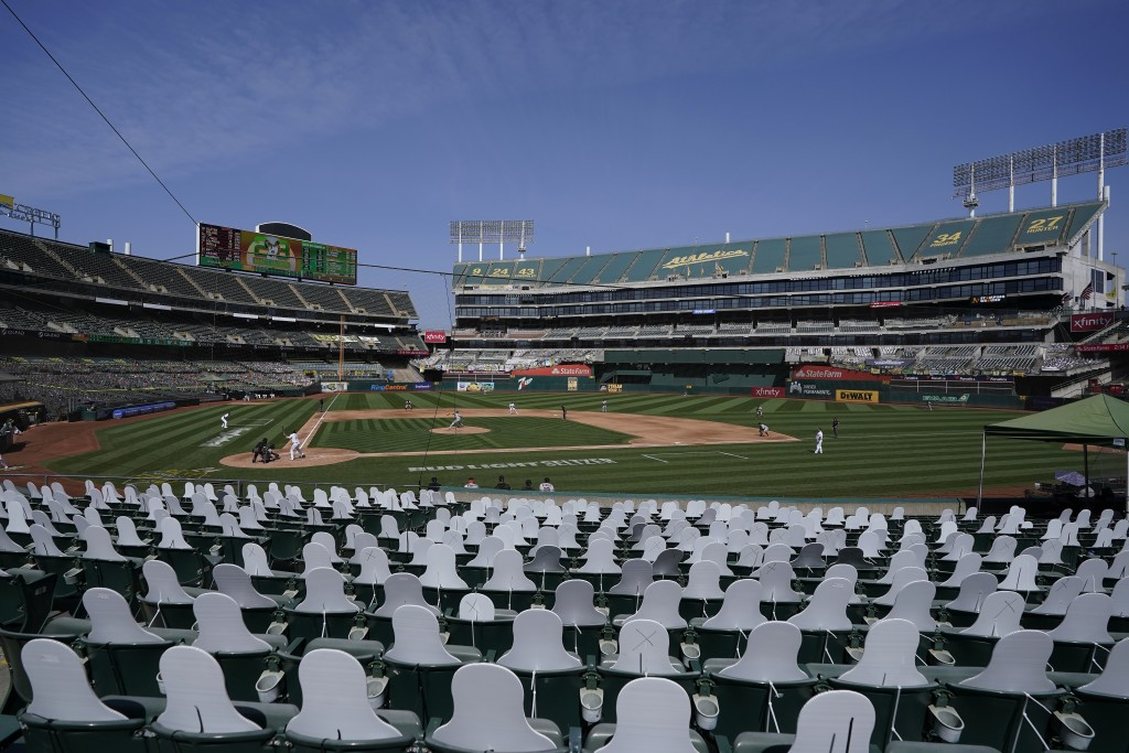 Cutouts are seated at Oakland Coliseum as San Francisco Giants' Kevin Gausman pitches to Oakland Athletics' Matt Olson during the fourth inning of a b...