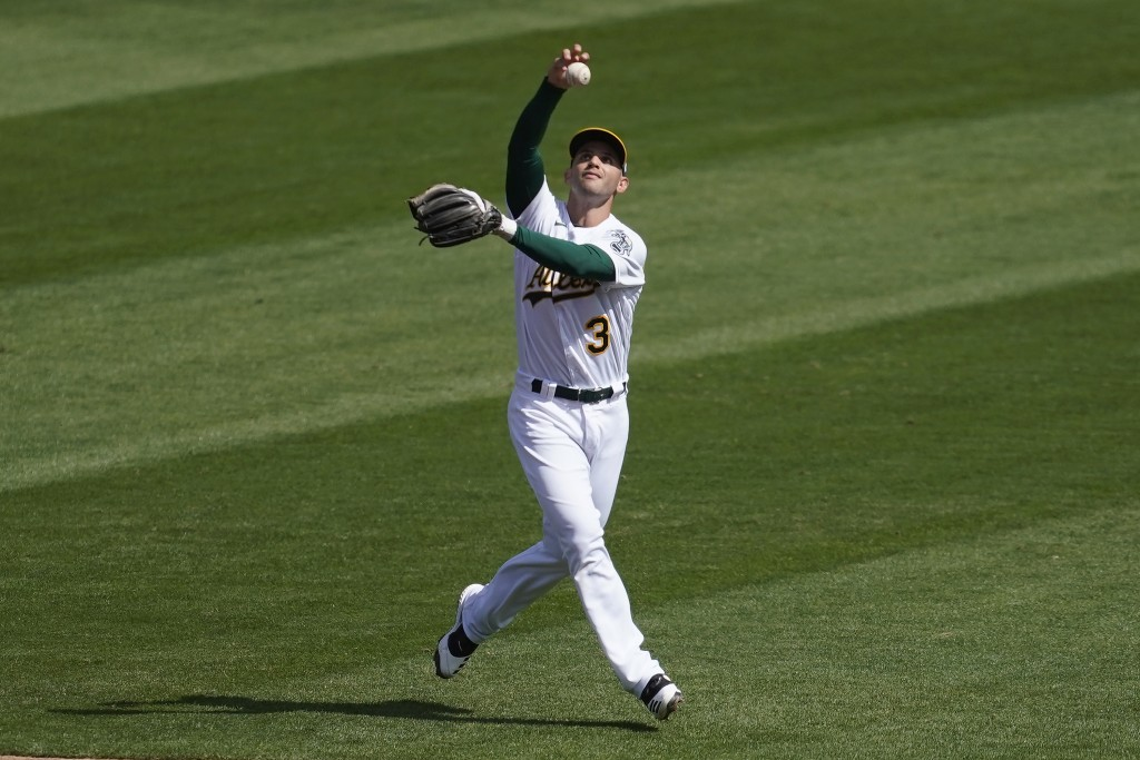 Oakland Athletics second baseman Tommy La Stella makes a fielding error on a ground ball hit by San Francisco Giants' Luis Alexander Basabe during the...