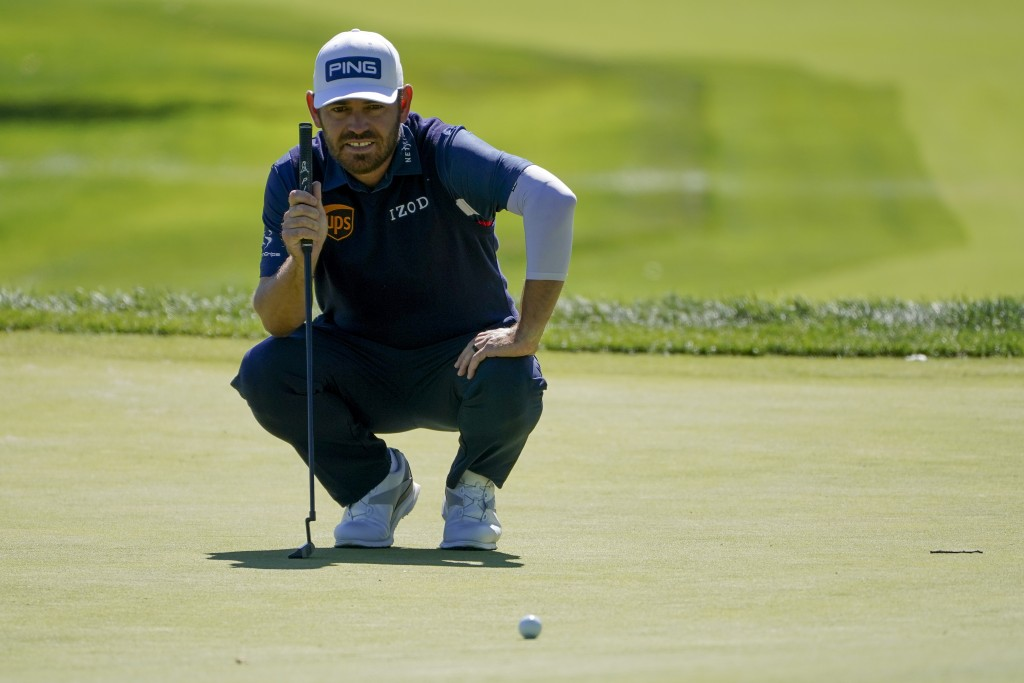 Louis Oosthuizen, of South Africa, lines up a putt on the second green during the third round of the US Open Golf Championship, Saturday, Sept. 19, 20...