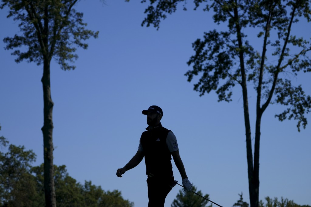Dustin Johnson, of the United States, walks along the third fairway during the third round of the US Open Golf Championship, Saturday, Sept. 19, 2020,...