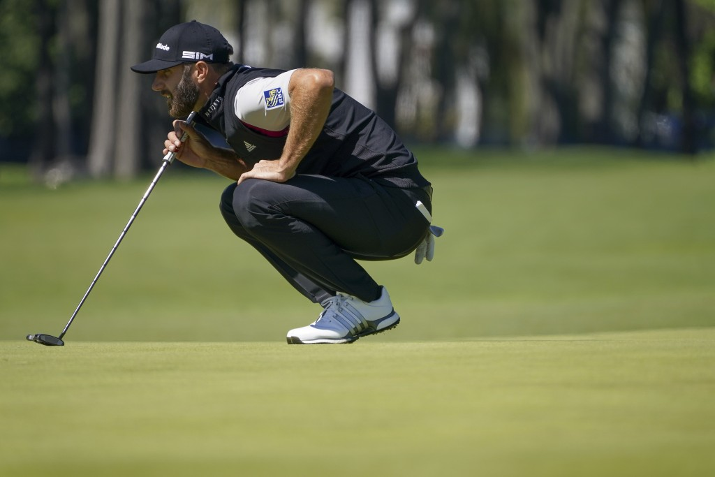 Dustin Johnson, of the United States, lines up a putt on the fifth green during the third round of the US Open Golf Championship, Saturday, Sept. 19, ...