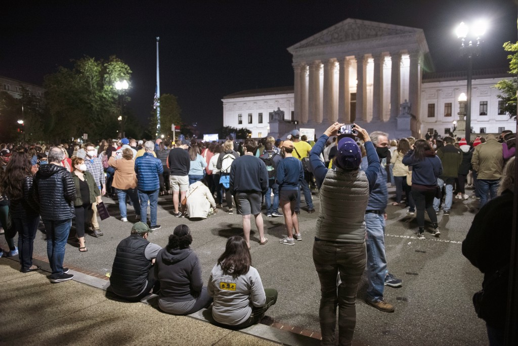 People gather at the Supreme Court to honor the late Justice Ruth Bader Ginsburg, Saturday, Sept. 19, 2020, in Washington.  (AP Photo/Cliff Owen)