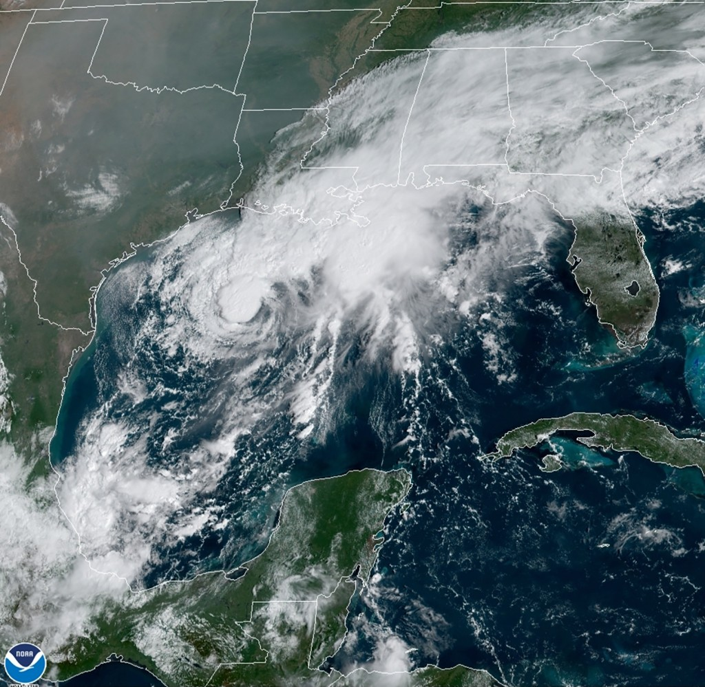 This GOES-16 GeoColor satellite image taken Saturday, Sept. 19, 2020, and provided by NOAA, shows Tropical Storm Beta, center,  in the Gulf of Mexico....