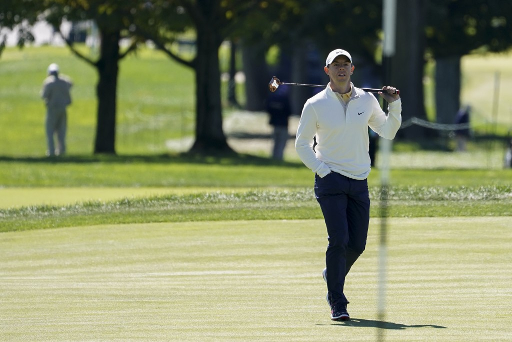 Rory McIlroy, of Northern Ireland, checks his lie on the first green during the third round of the US Open Golf Championship, Saturday, Sept. 19, 2020...