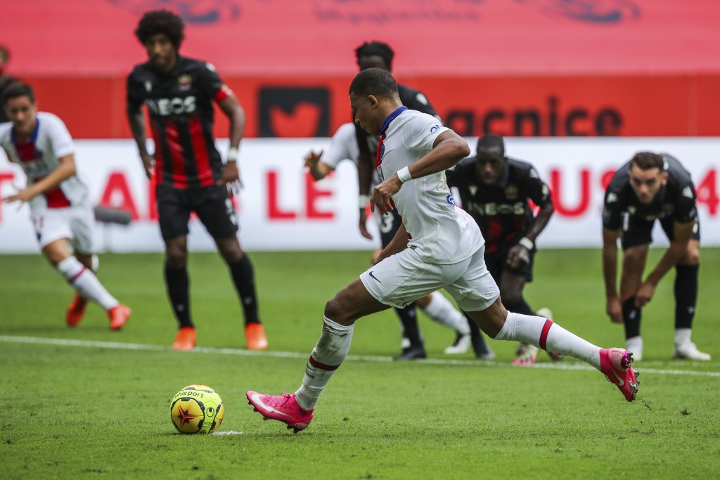 PSG's Kylian Mbappe scores a penalty shoot during the French League One soccer match between Nice and Paris Saint-Germain at the Allianz Riviera stadi...
