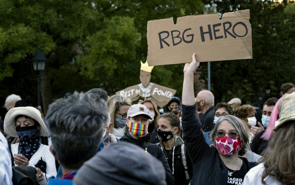 People gather at Washington Square Park in New York Saturday, Sept. 19, 2020, a day after the death of Justice Ruth Bader Ginsburg. (AP Photo/Craig Ru...