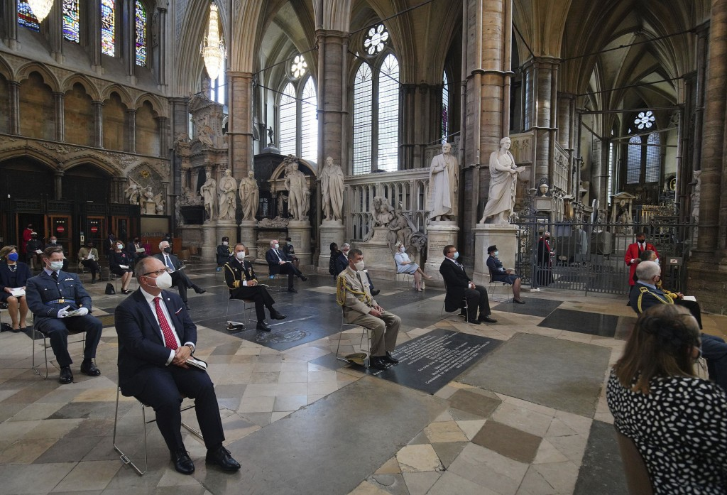 Attendees socially distance during a service to mark the 80th anniversary of the Battle of Britain at Westminster Abbey, London, Sunday, Sept. 20, 202...