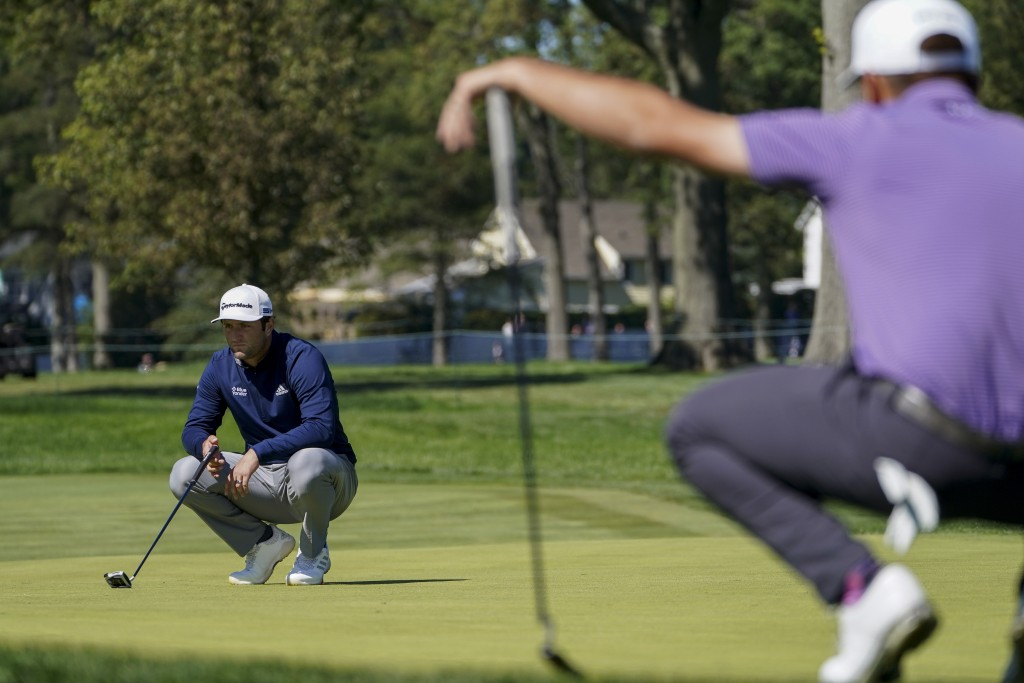 Jon Rahm, of Spain, lines up a putt on the fifth green during the third round of the US Open Golf Championship, Saturday, Sept. 19, 2020, in Mamaronec...