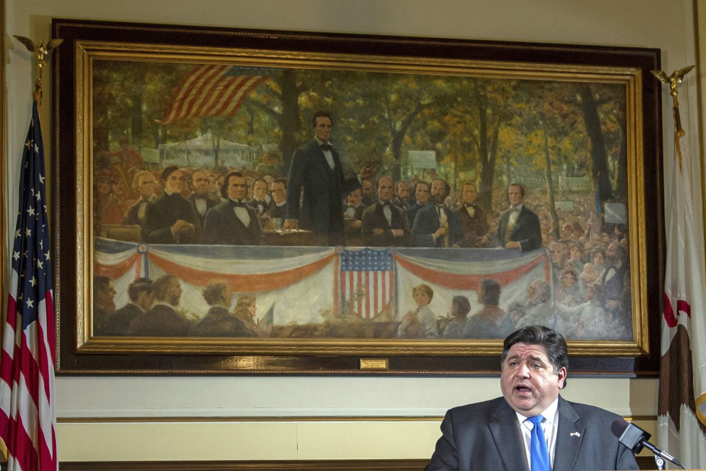 FILE - In this May 22, 2020 file photo, Illinois Gov. JB Pritzker answers questions from the media, from his office at the Illinois State Capitol, in ...