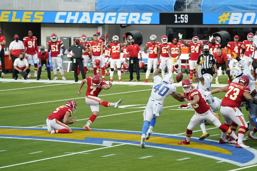Kansas City Chiefs kicker Harrison Butker (7) hits the game-winning field goal during overtime of an NFL football game against the Los Angeles Charger...