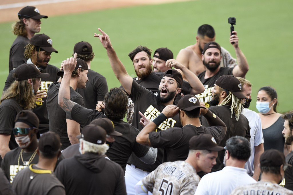 San Diego Padres shortstop Eric Hosmer, center, celebrates after the Padres beat the Seattle Mariners in a baseball game Sunday, Sept. 20, 2020, in Sa...