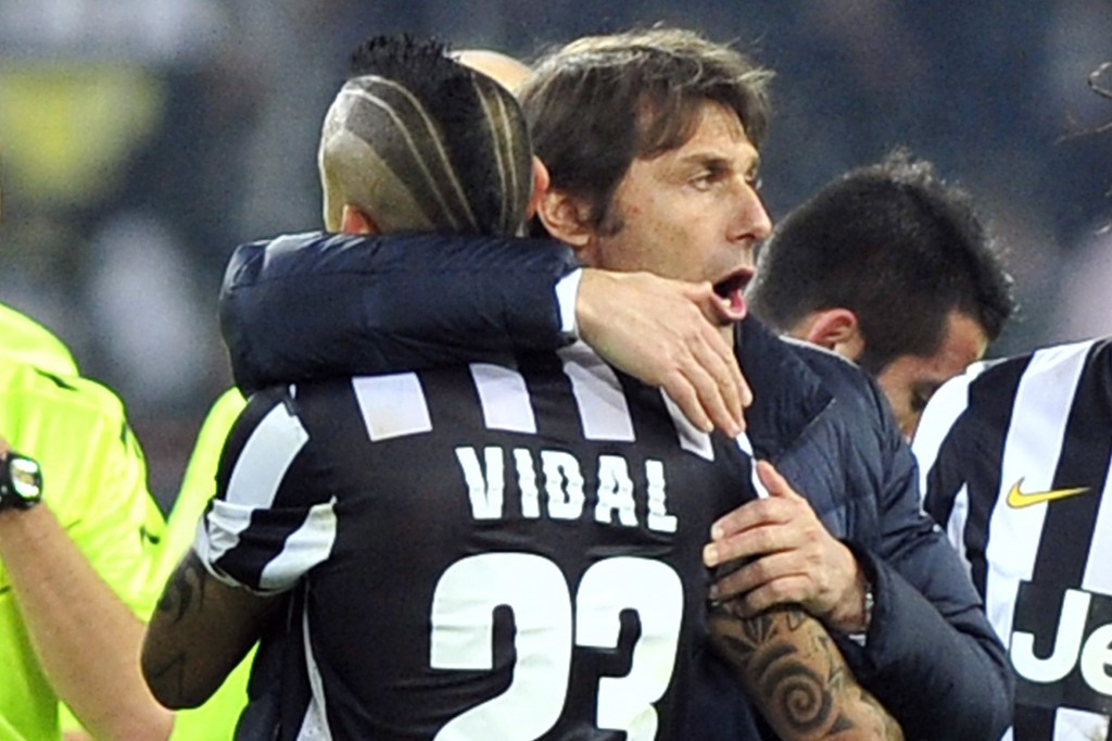 FILE - In this Feb. 2, 2014 file photo, then Juventus coach Antonio Conte, celebrates with Arturo Vidal after a Serie A soccer match between Juventus ...
