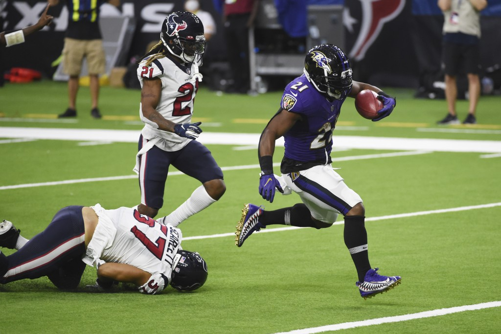 Baltimore Ravens running back Mark Ingram (21) runs for a touchdown against the Houston Texans during the second half of an NFL football game Sunday, ...