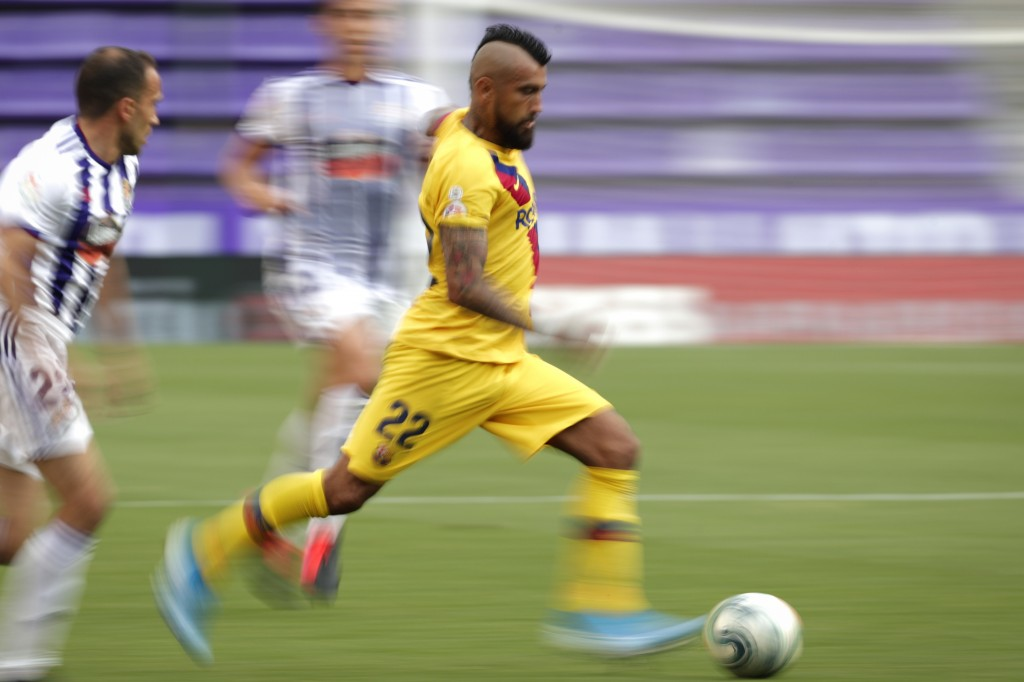 FILE - In this  July 11, 2020 file photo, Barcelona's Arturo Vidal controls the ball during the Spanish La Liga soccer match between Valladolid and FC...