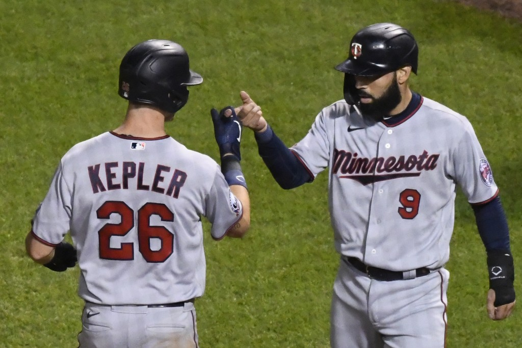 Minnesota Twins' Max Kepler (26) celebrates with Minnesota Twins' Marwin Gonzalez (9) after they scored on Kepler's two-run home run during the sevent...