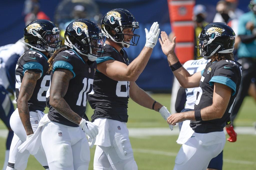 Jacksonville Jaguars tight end Tyler Eifert (88) is congratulated by quarterback Gardner Minshew, right, after teaming up for a 19-yard touchdown pass...