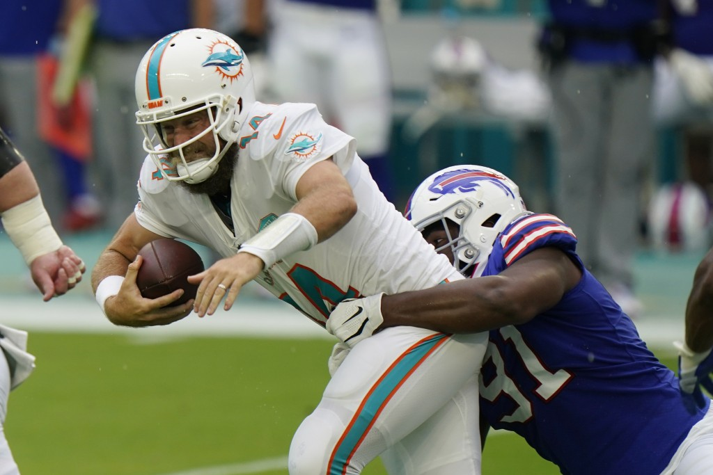 Buffalo Bills defensive tackle Ed Oliver (91) sacks Miami Dolphins quarterback Ryan Fitzpatrick (14)during the first half of an NFL football game, Sun...