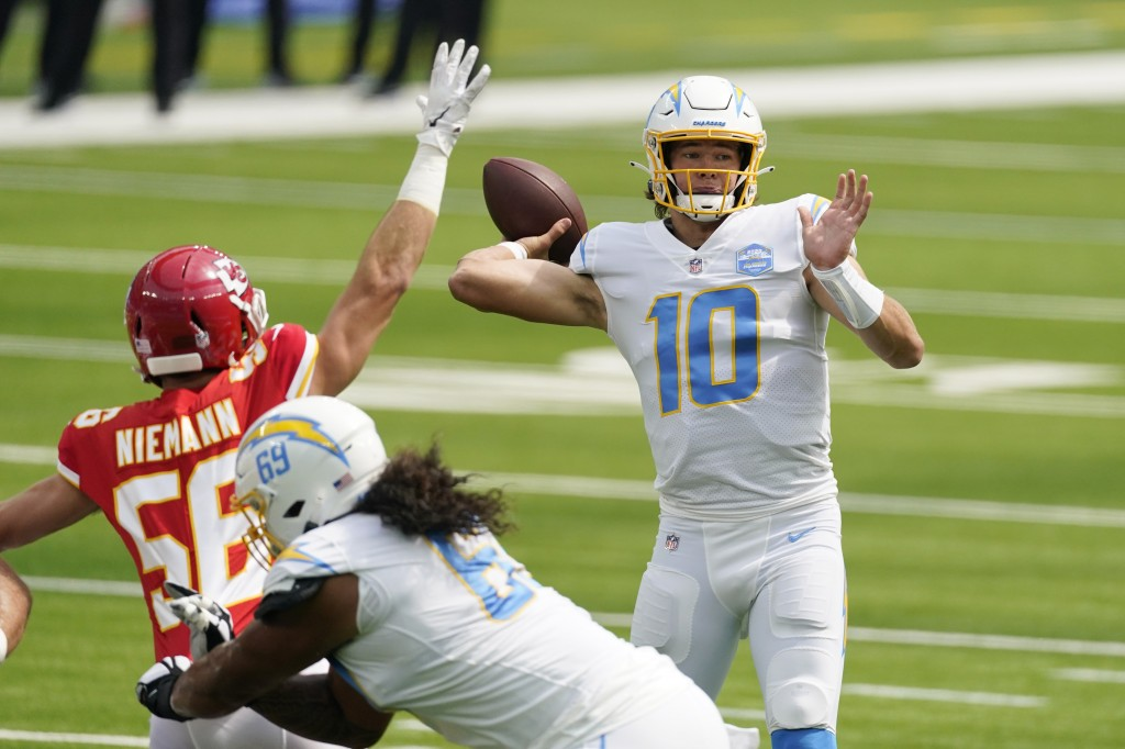 Los Angeles Chargers quarterback Justin Herbert (10) throws against the Kansas City Chiefs during the first half of an NFL football game Sunday, Sept....