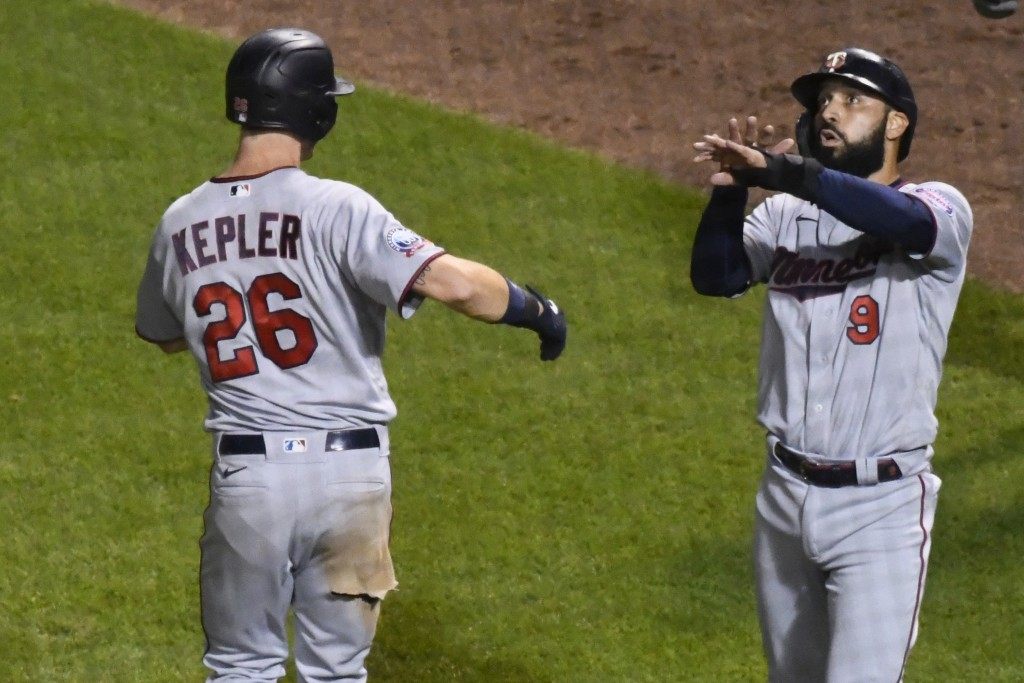 Minnesota Twins' Max Kepler (26) celebrates with Minnesota Twins' Marwin Gonzalez (9) after they score on Kepler's two-run home run during the seventh...
