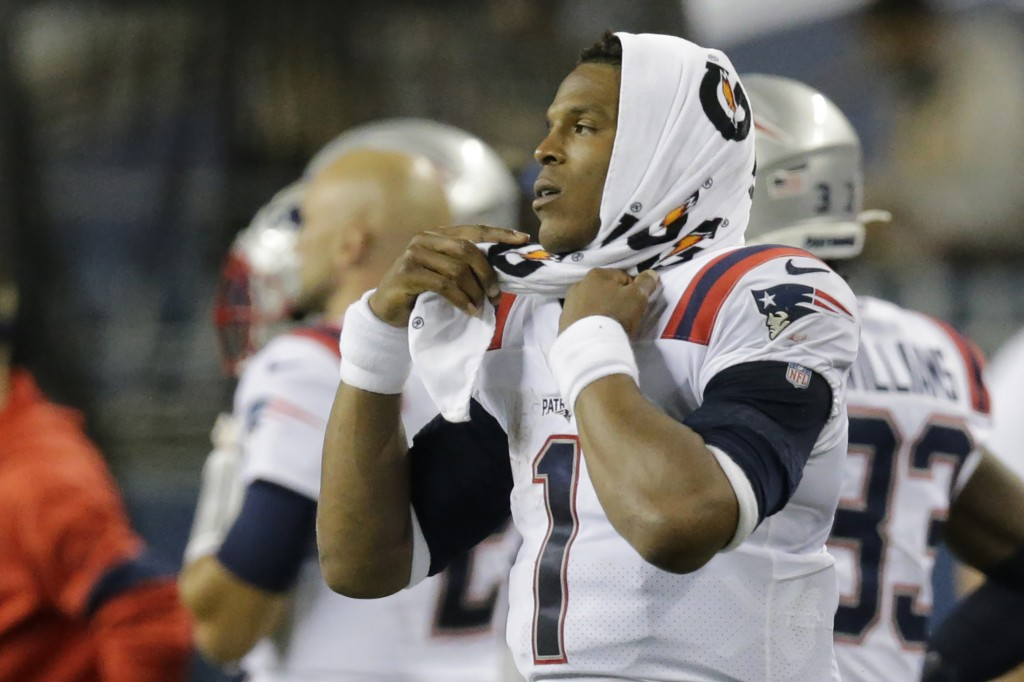 New England Patriots quarterback Cam Newton (1) reacts on the sideline during the fourth quarter of an NFL football game against the Seattle Seahawks,...