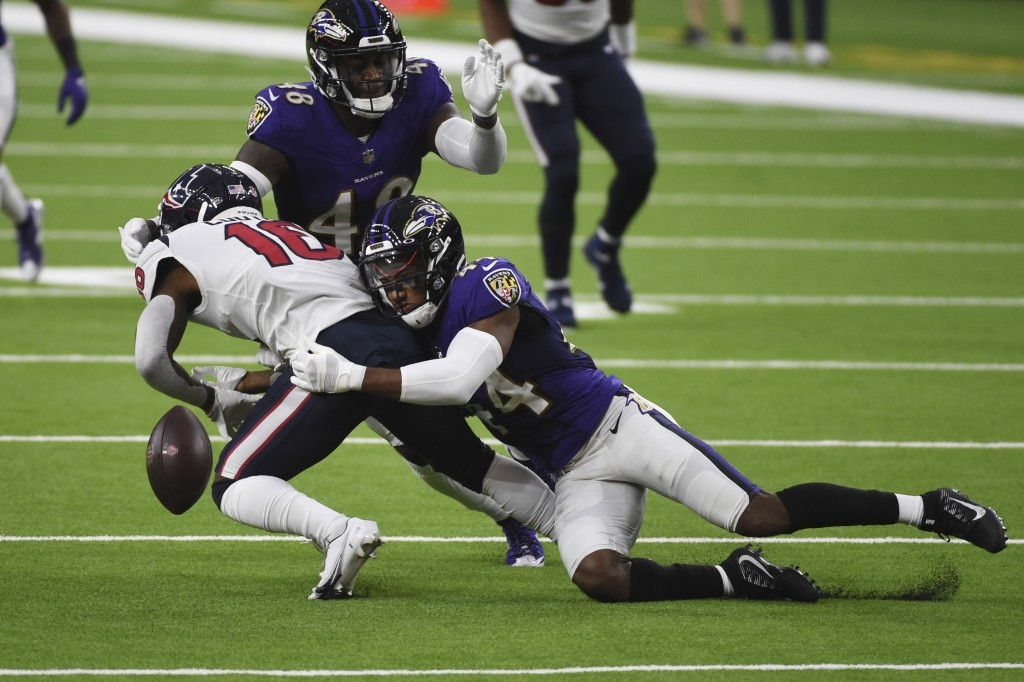 Baltimore Ravens cornerback Marlon Humphrey (44) caused Houston Texans wide receiver Keke Coutee (16) to fumble during the first half of an NFL footba...