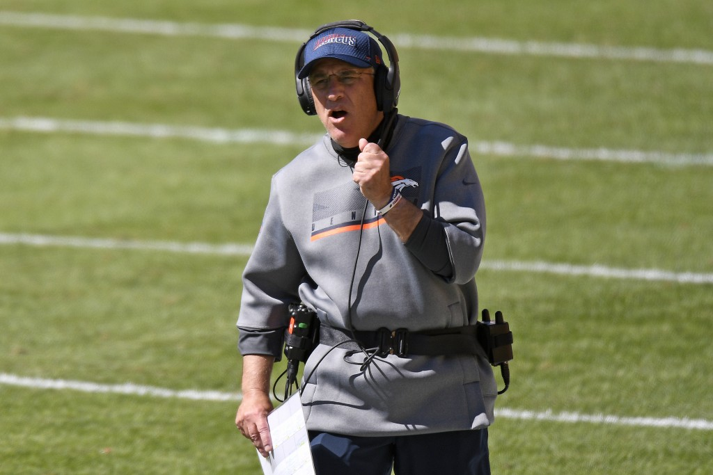 Denver Broncos head coach Vic Fangio walks the sideline during the first half of an NFL football game against the Pittsburgh Steelers in Pittsburgh, S...
