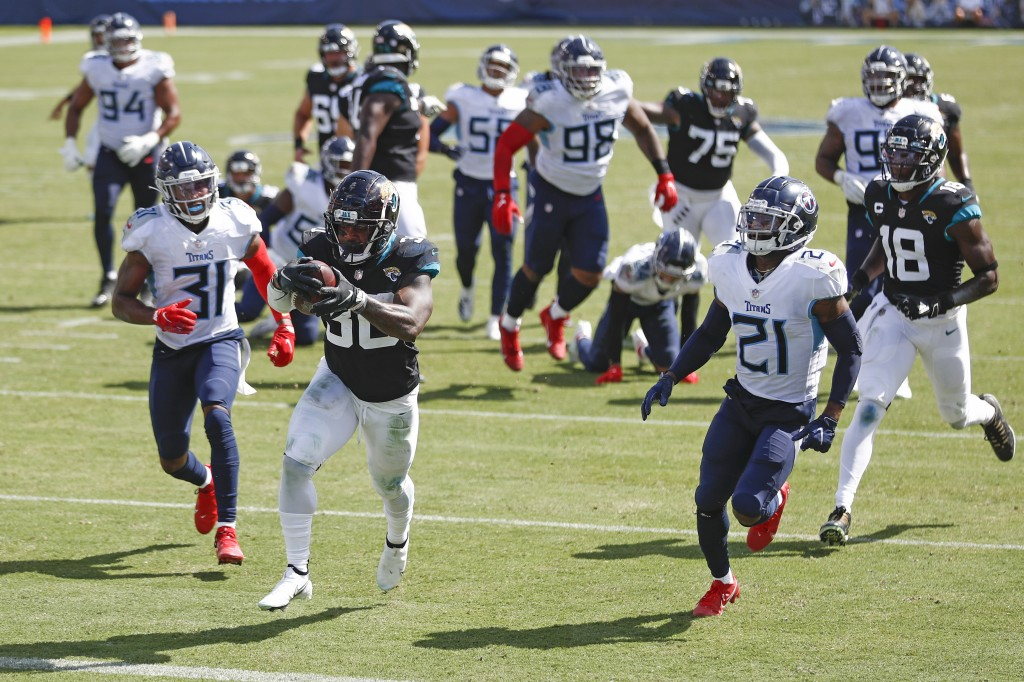 Jacksonville Jaguars running back James Robinson (30) scores a touchdown on a 17-yard run against the Tennessee Titans in the second half of an NFL fo...