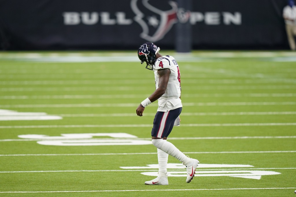 Houston Texans quarterback Deshaun Watson (4) walks off the field after failing to convert on a third down against the Baltimore Ravens during the sec...