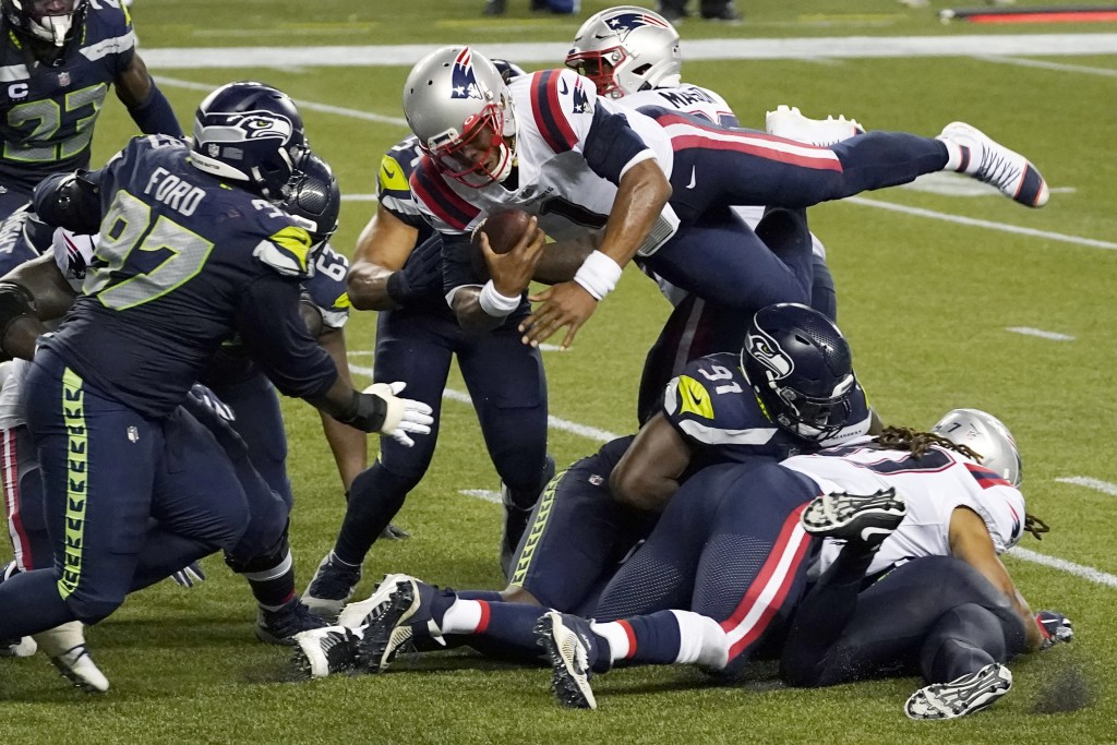 New England Patriots quarterback Cam Newton dives with the ball but is stopped near the goal line as the clock expires in the fourth quarter of an NFL...