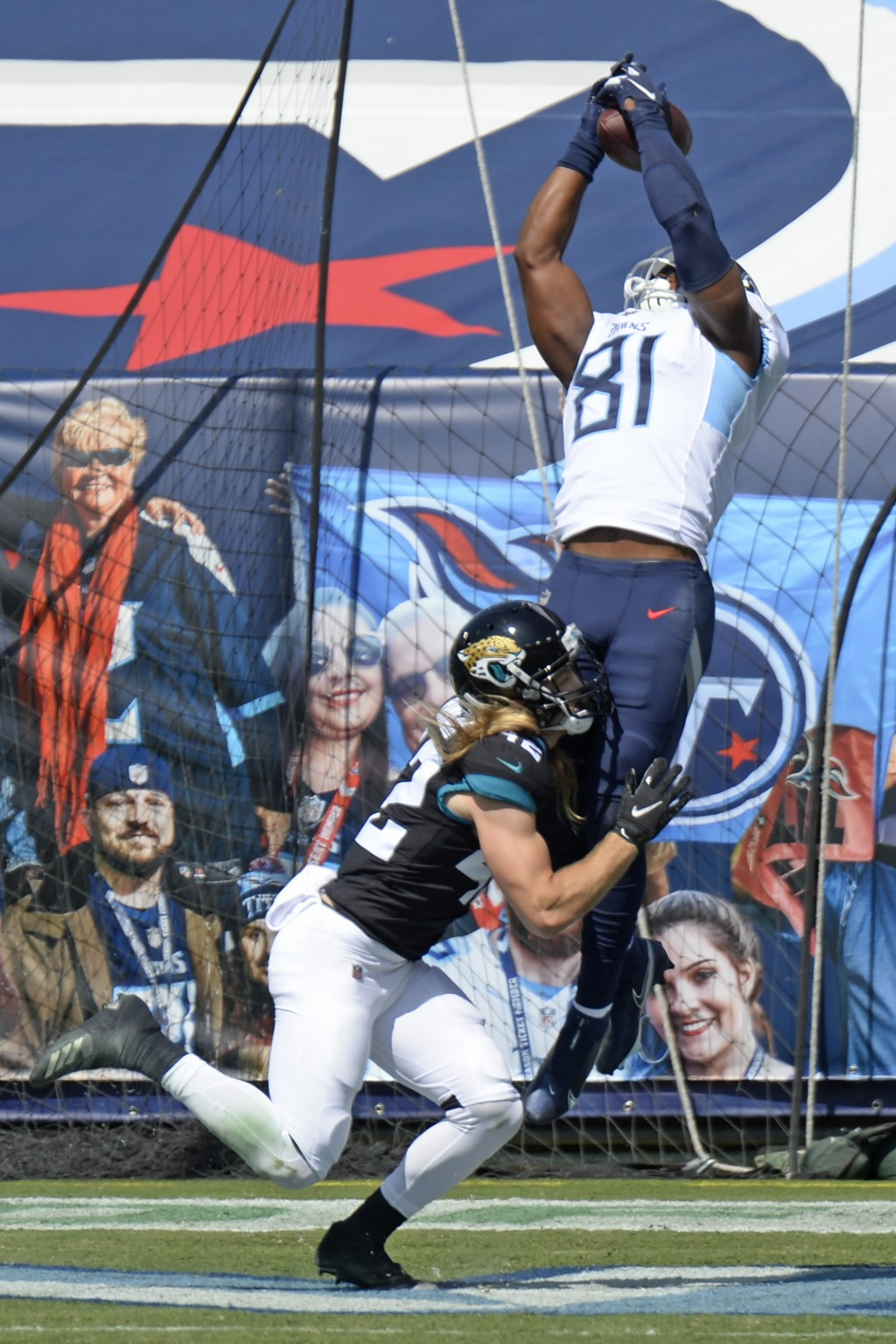 Tennessee Titans tight end Jonnu Smith (81) catches a touchdown pass over Jacksonville Jaguars safety Andrew Wingard (42) in the first half of an NFL ...