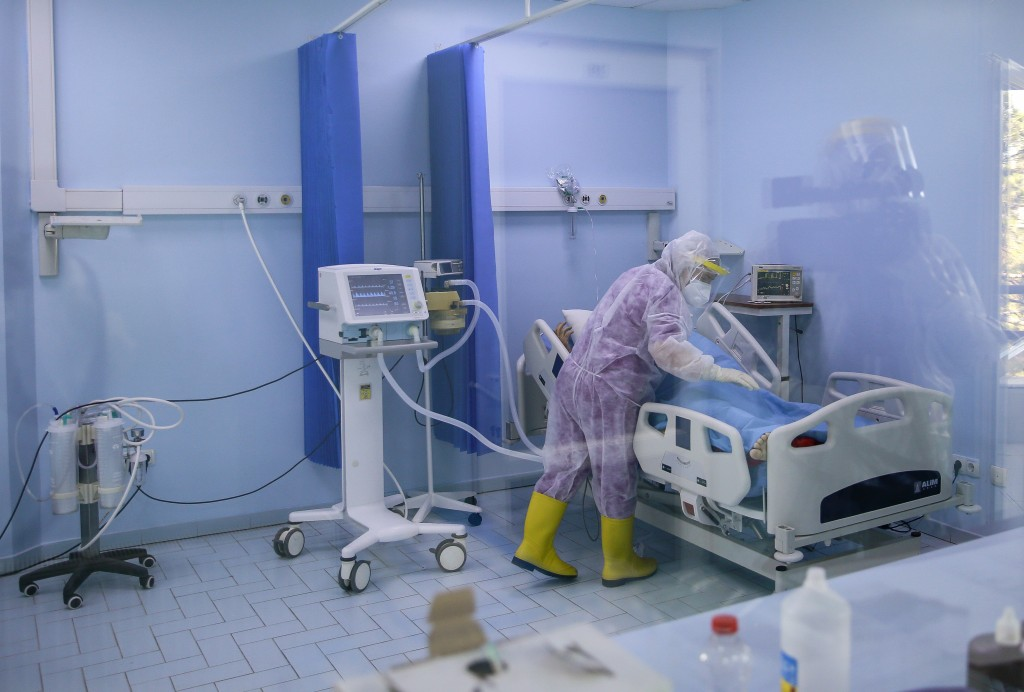 A nurse inside the Intensive Care Unit attends to a patient with COVID-19 in the Clinic for Infectious Diseases during the ongoing Coronavirus pandemi...