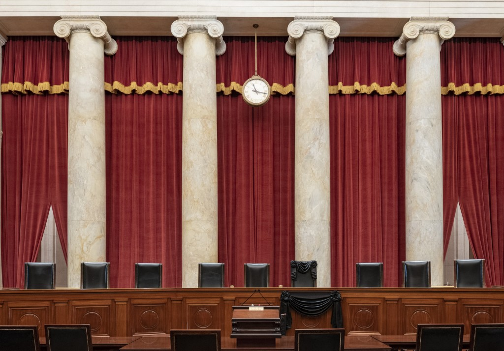 This Sept. 19, 2020, photo provided by the Supreme Court, shows the Bench draped for the death of Supreme Court Associate Justice Ruth Bader Ginsburg ...