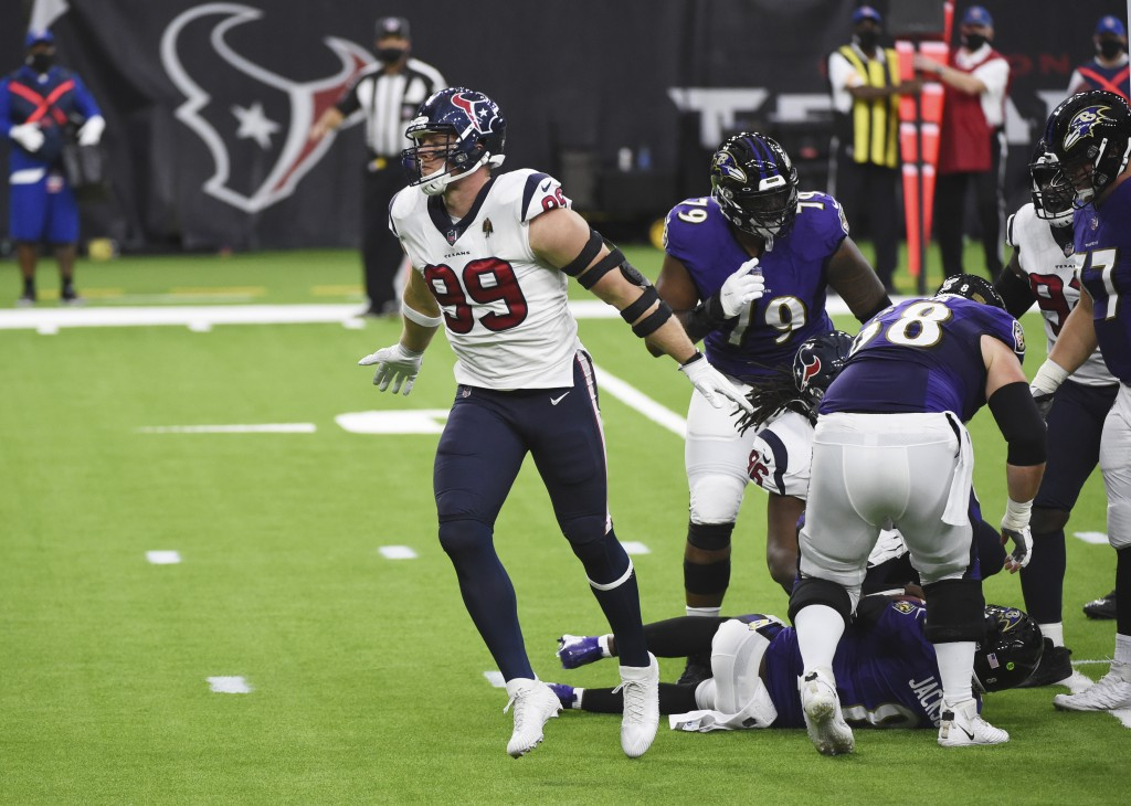 Houston Texans defensive end J.J. Watt (99) celebrates after sacking Baltimore Ravens quarterback Lamar Jackson during the first half of an NFL footba...