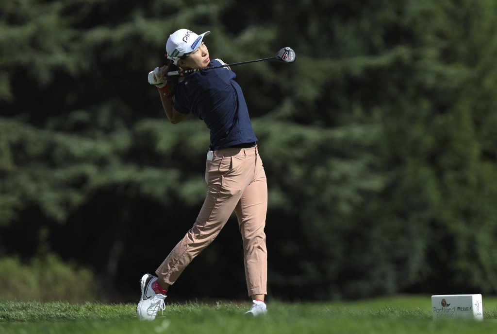 Hinako Shibuno, of Japan, watches her tee shot on the 11th hole during the final round of the LPGA Cambia Portland Classic golf tournament in Portland...