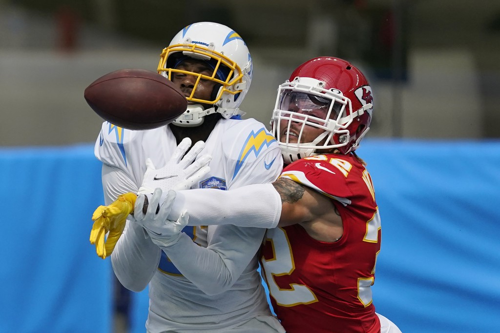 Kansas City Chiefs free safety Tyrann Mathieu, right, breaks up a pass intended for Los Angeles Chargers wide receiver Mike Williams during the first ...