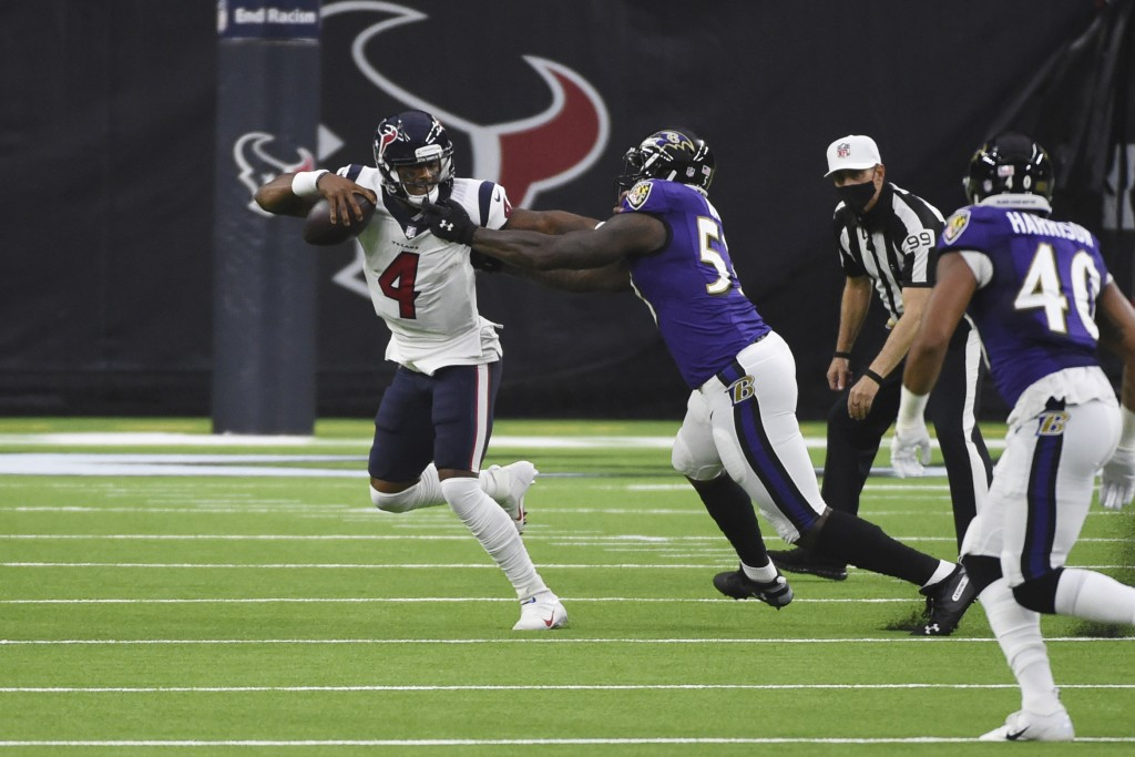 Houston Texans quarterback Deshaun Watson (4) is pressured by Baltimore Ravens defensive end Jihad Ward (53) during the first half of an NFL football ...