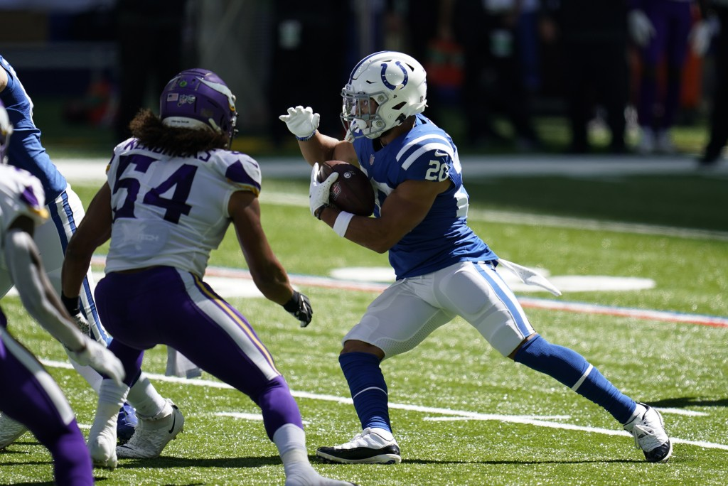 Indianapolis Colts' Jonathan Taylor (28) runs against Minnesota Vikings' Eric Kendricks (54) during the first half of an NFL football game, Sunday, Se...