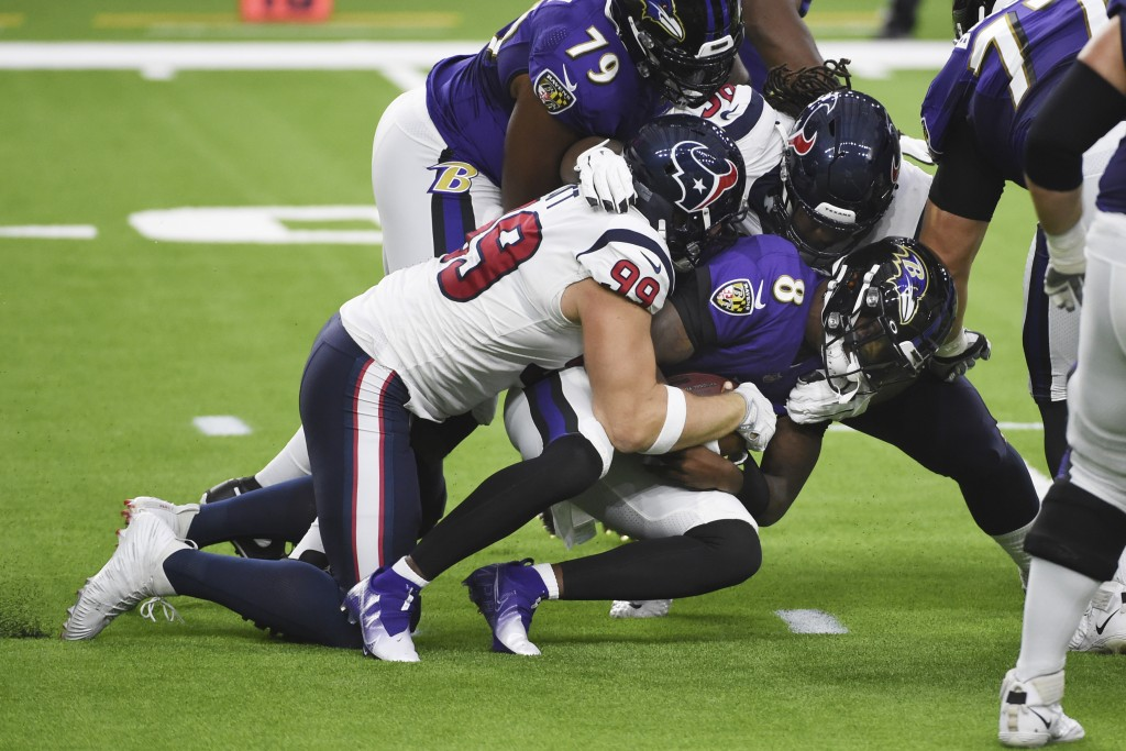 Baltimore Ravens quarterback Lamar Jackson (8) is sacked by Houston Texans defensive end J.J. Watt (99) during the first half of an NFL football game ...