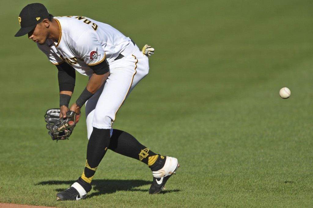 Pittsburgh Pirates' Erik Gonzalez misplays a ball hit by St. Louis Cardinals' Brad Miller during the fourth inning of a baseball game, Sunday, Sept. 2...