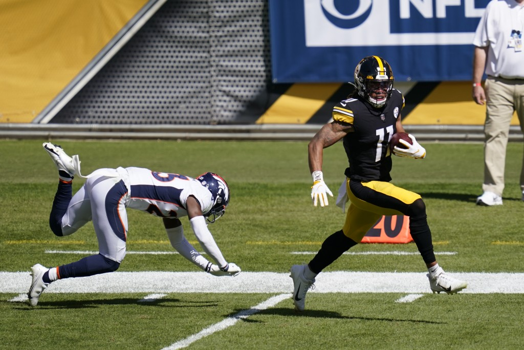 Pittsburgh Steelers wide receiver Chase Claypool (11) gets past Denver Broncos cornerback Michael Ojemudia (23) on an 84 yard touchdown play during th...